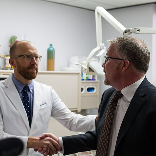 Fargo dentist, Dr. Harnish, shaking hands with his patient.