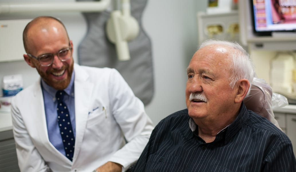 Dr. Harnish and his patient discussing treatment plans.