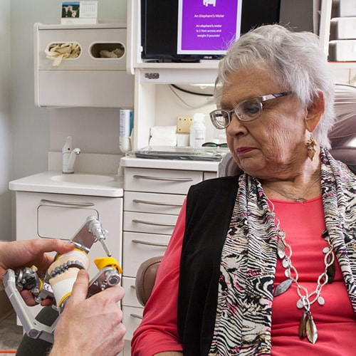 A patient is shown how her bite alignment will be adjusted with comprehensive treatment