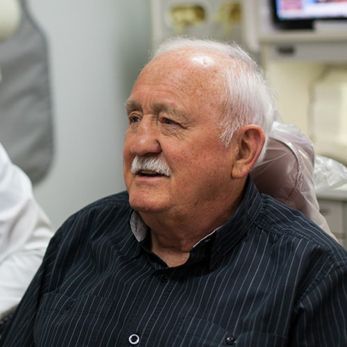 An older patient who's smile was helped with dental bridges