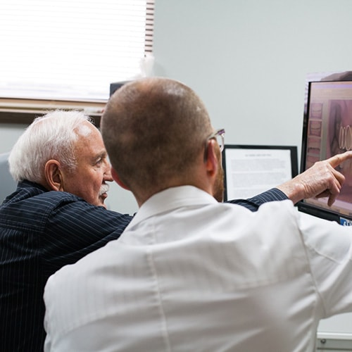 Dr. Harnish talks with a patient about his comprehensive exam